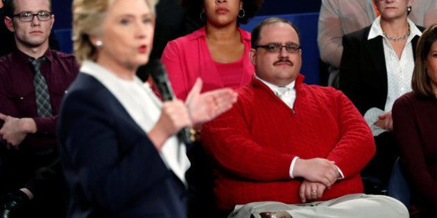 Ken Bone (R), an uncommitted voter who is a power plant employee from Belleville, Illinois, listens to...