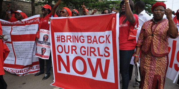 FILE - In this file photo taken Tuesday, Oct. 14, 2014, people demonstrate calling on the Nigerian government to rescue girls