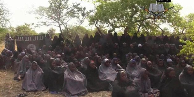 FILE - This Monday May 12, 2014 file image taken from video by Nigeria's Boko Haram terrorist network, shows the alleged miss