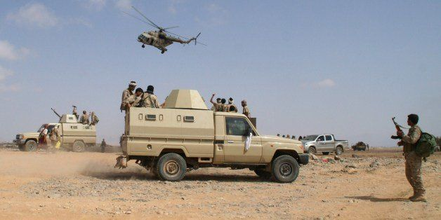 Yemeni troops they take part in an offensive against extremists in the southern province of Shabwa, on May 7, 2014. The offen