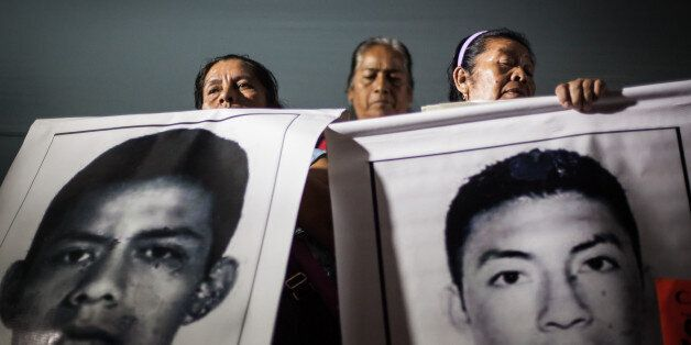 MEXICO CITY, MEXICO - NOVEMBER 5: Parents of the 43 missing students, attend the third massive protest against the disappeara