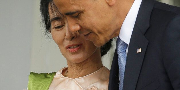 U.S. President Barack Obama, right, walks out with Myanmar opposition leader Aung San Suu Kyi after addressing members of the