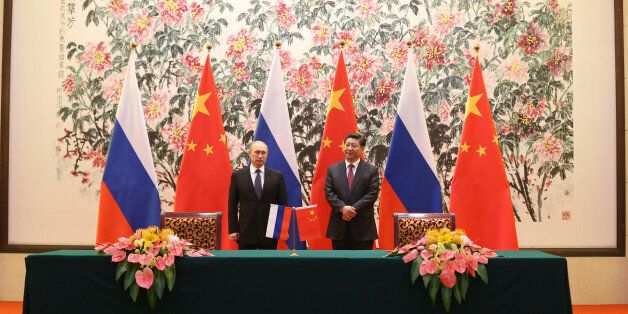 BEIJING, CHINA - NOVEMBER 9: Russian President Vladimir Putin  and Chinese President Xi Jinping attend a Bilateral Meeting at