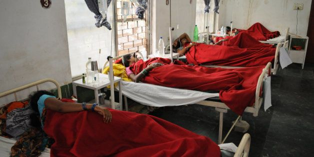 Indian women who underwent sterilization surgeries receive treatment at the District Hospital in Bilaspur, in the central Ind