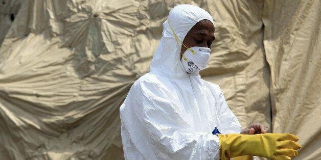JAKARTA, INDONESIA - NOVEMBER 12: Indonesian health officials conduct simulation exercises for Ebola preparedness involving m