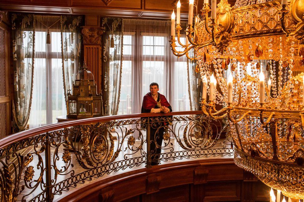 A guide stands in the grand foyer at Mezhyhirya, the former private estate of former president Viktor Yanukovych which is now