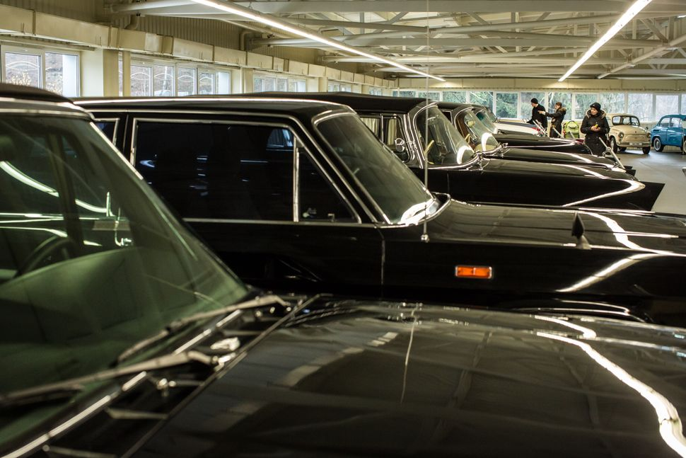 People visit a collection of antique cars at Mezhyhirya, the former private estate of former president Viktor Yanukovych whi