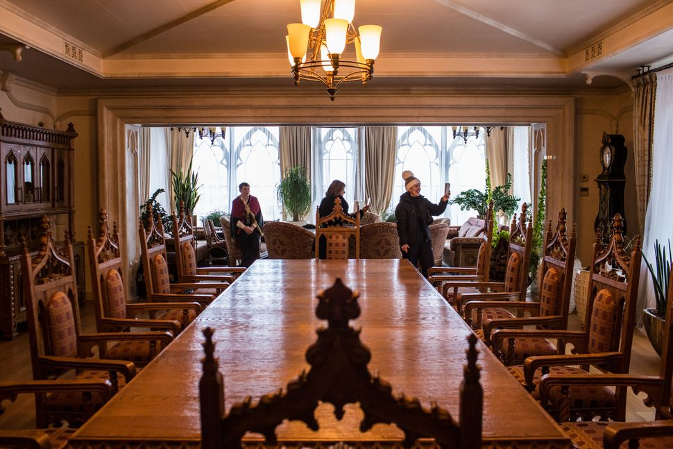 Visitors take pictures in the dining room at Mezhyhirya, the former private estate of former president Viktor Yanukovych whi
