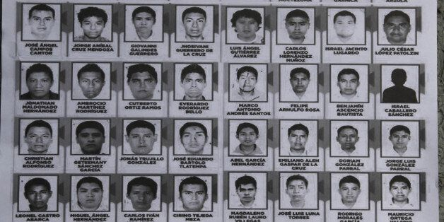 A poster seen at a demonstration at the Angel of Independence, shows images of the 43 disappeared rural college students, in