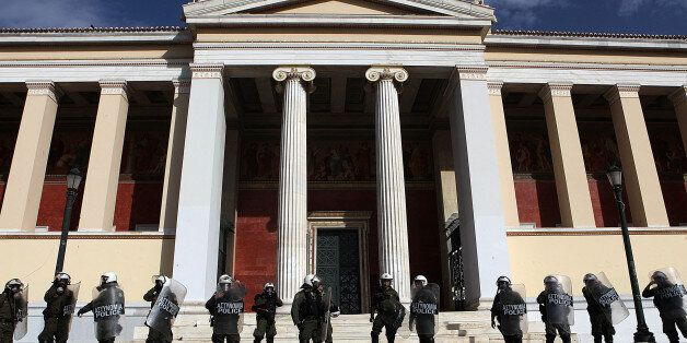 ATHENS, GREECE - NOVEMBER 13: Greek security forces stand guard in front of the Parliament building on November 13, 2014 duri