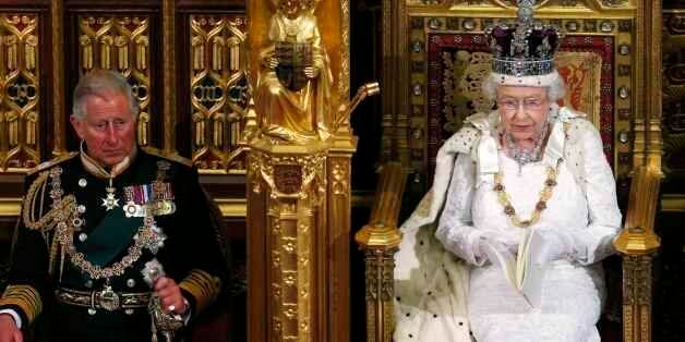 Britain's Queen Elizabeth II, right, sits with Prince Charles, as she delivers her speech in the House of Lords, during the S