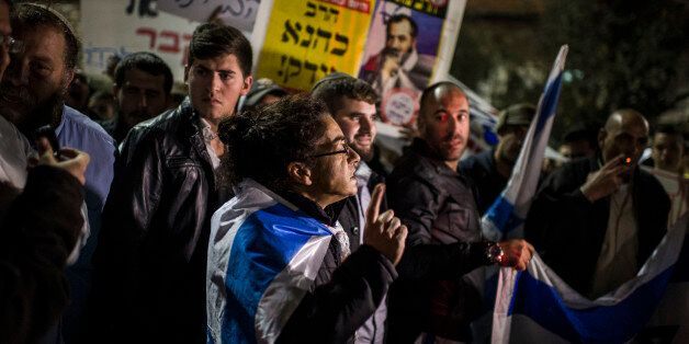 JERUSALEM, ISRAEL - NOVEMBER 18:  Right-wing activists protest on November 18, 2014 in Jerusalem, Israel. The right-wing demo