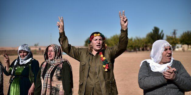 Kurdish women shout slogans as they demonstrate in the southeastern border village of Mursitpinar, Sanliurfa province, on Nov
