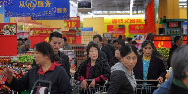 CHONGQING, CHINA - OCTOBER 25:  (CHINA OUT) People purchase goods at a Walmart supermarket on October 25, 2011 in Chongqing,