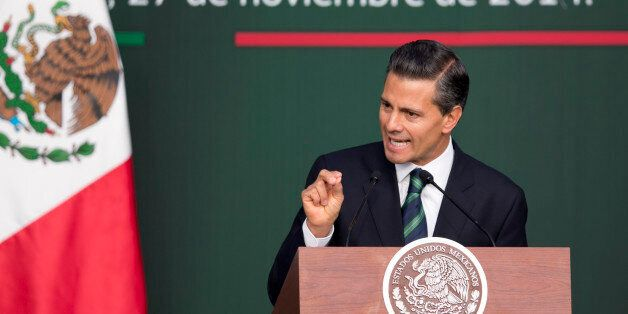 Mexico's President Enrique Pena Nieto speaks during a ceremony at the National Palace in Mexico City, Thursday, Nov. 27, 2014
