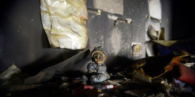 Damages are seen in a classroom of a bilingual Hebrew and Arabic school in Jerusalem, Sunday, Nov. 30, 2014. A police spokesw