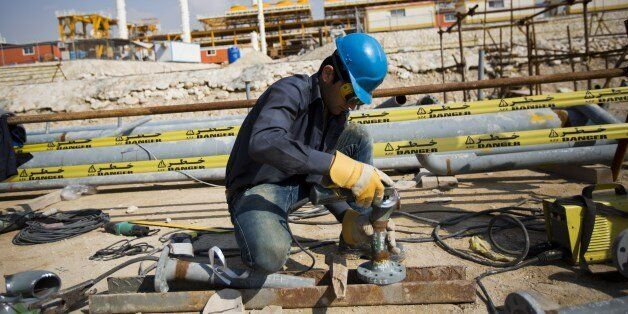 An Iranian man works at the phase 19 of the South Pars gas field facilities near the southern town of Kangan on the shore of