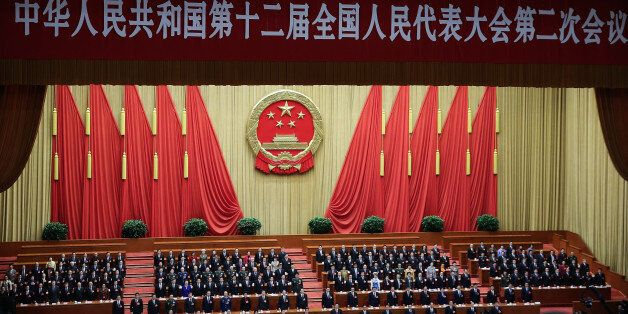 BEIJING, CHINA - MARCH 13:  People attend the closing session of the National People's Congress (NPC) at the Great Hall of the People on March 13, 2014 in Beijing, China. During the congress China announced plans to raise its defense budget by 12.2 percent to 808.2 billion yuan (about 132 billion U.S. dollars) in 2014, about a quarter of the U.S military budget.  (Photo by Lintao Zhang/Getty Images)