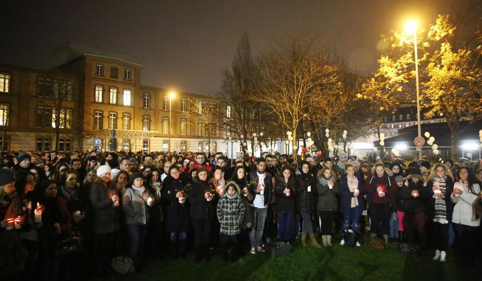 Mourners gather outside the Sana clinic to commemorate Tugce Albayrak on her 23rd birthday, Nov. 28, 2014 in Offenbach, Germa