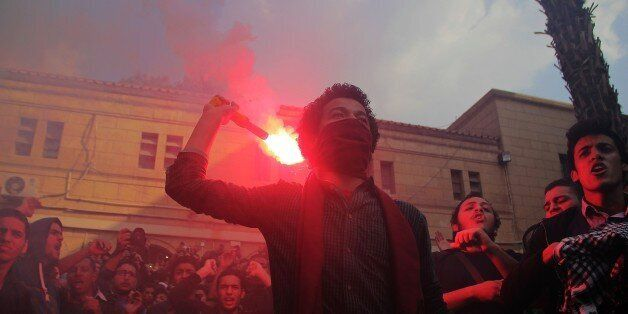 GIZA, EGYPT - NOVEMBER 30: Hundreds of Anti-coup Egyptians stage demonstrations at University of Cairo in Giza, Egypt on Nove