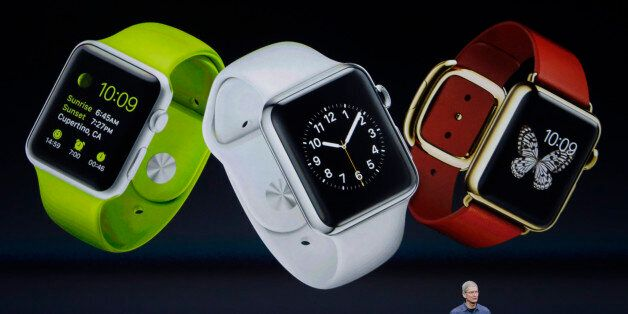 Apple CEO Tim Cook introduces Apple Watch  on Tuesday, Sept. 9, 2014, in Cupertino, Calif. (AP Photo/Marcio Jose Sanchez)