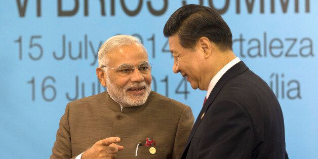 India's Prime Minister Narendra Modi, left, talks with China's President Xi Jinping, as South Africa's President Jacob Zuma l
