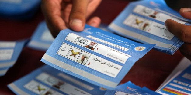 An Afghan election commission worker sort ballots for an audit of the presidential run-off votes at an election commission of