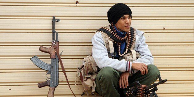 A fighter loyal to Khalifa Haftar, a retired general and former chief of staff for Moamer Kadhafi, takes a break as they figh