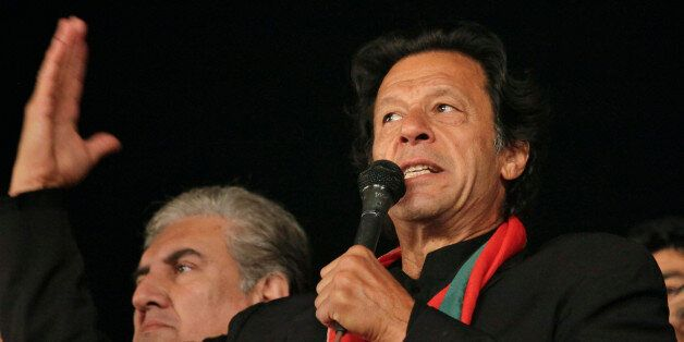 Pakistan's cricketer-turn-politician Imran Khan, leader of Pakistan Tehreek-e-Insaf party, addresses to his supporters during