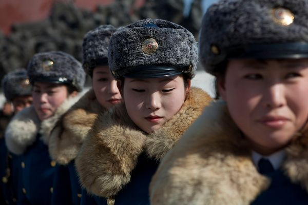 "A North Korean negotiator threatens to turn Seoul into ""a sea of fire.""<br><br>   <em>Caption: Female North Korean traffic po"