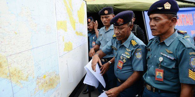 SURABAYA, INDONESIA - DECEMBER 29: Indonesian naval officers prepare the operational air navigation map during the investigation of missing AirAsia flight QZ8501 outside the crisis center of Juanda International Airport Surabaya on December 29, 2014 in Surabaya, Indonesia. AirAsia announced that flight QZ8501 from Surabaya to Singapore, with 162 people on board, lost contact with air traffic control at 07:24 a.m. local time on December 28. (Photo by Robertus Pudyanto/Getty Images)