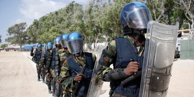 Somali police with full combat gear march at the police academy compound during the 71st anniversary of the police force, in