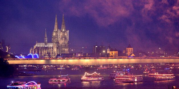 In this picture made available Sunday July 14, 2013, illuminated ships cruising on the river Rhine in front of the old town o