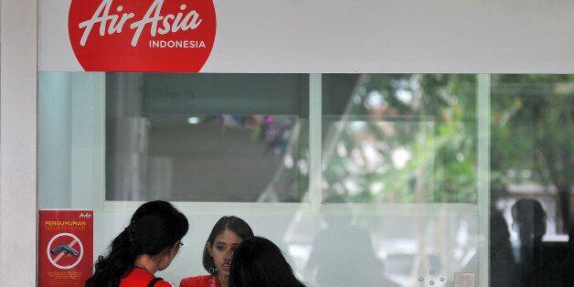 SURABAYA, INDONESIA - JANUARY 03: Candidate passengers' cancellation process of AirAsia airline flight tickets from Surabaya