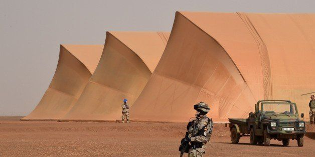 A Spanish soldier of the detachment of the Operation Barkhane stands guard at a French base outside the northern Malian city