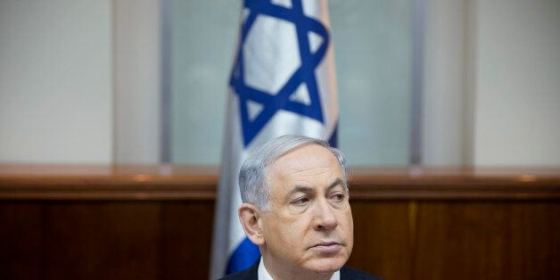 Israeli Prime Minister Benjamin Netanyahu attends a weekly cabinet meeting in Jerusalem, Sunday, Jan. 4, 2015. (AP Photo/Oded
