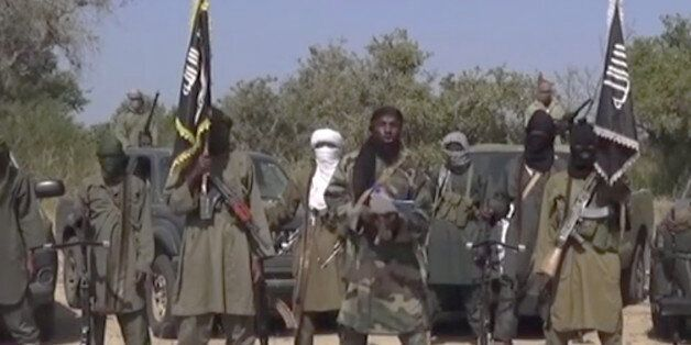 This Friday Oct. 31, 2014 image taken from video by Nigeria's Boko Haram terrorist network, the leader of Nigeria's Islamic e