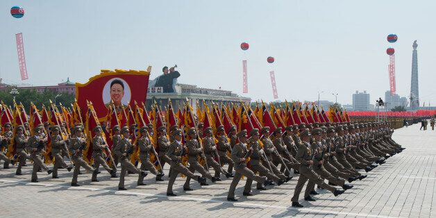 In a photo taken on July 27, 2013 North Korean soldiers march on Kim Il-Sung square during a military parade marking the 60th