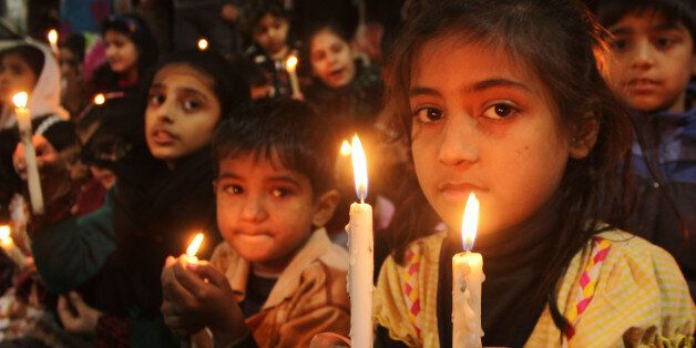 LAHORE, PUNJAB, PAKISTAN - 2014/12/23: Pakistani students of  Study in School gather in a candlelight vigil for the  massacre