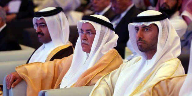 Qatar Oil Minister Mohammed bin Saleh Al-Sada (L), Saudi Oil Minister Ali al-Naimi, and United Arab Emirates Energy Minister Suhail bin Mohamed al-Mazroui (R) attend the opening session of the 10th Arab Energy Conference in Abu Dhabi, on December 21, 2014. 'Irresponsible' levels of output by producers from outside the OPEC oil cartel is among the main causes of the slump in prices, the United Arab Emirates energy minister told the energy forum. AFP PHOTO/MARWAN NAAMANI (Photo credit should read MARWAN NAAMANI/AFP/Getty Images)