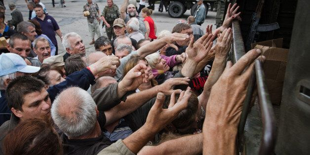 NIKOLAYEVKA, UKRAINE - 2014/07/06: The people waiting for their turn to have goods. The people of Slaviansk get the humanitar