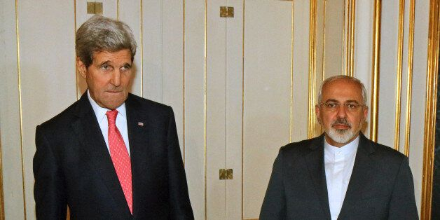U.S. Secretary of State John Kerry and Iranian Foreign Minister Mohammad Javad Zarif, right,  pose for a photograph prior to