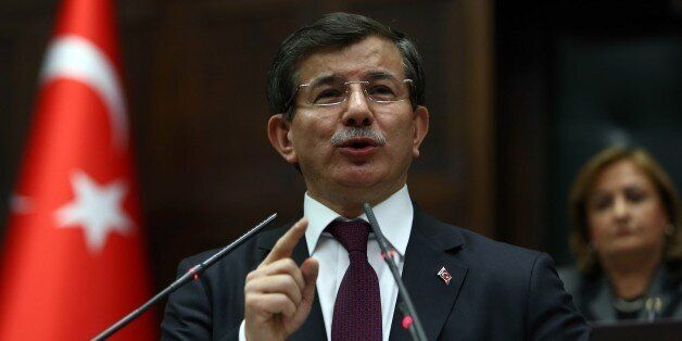 Turkey's Prime Minister Ahmet Davutoglu delivers a speech during the parliamentary group meeting of Turkey's ruling Justice a