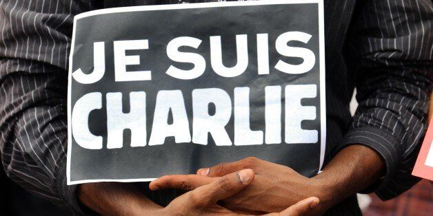 A person holds a sign reading in French 'I am Charlie' during a gathering of hundreds people at the Human Rights square in Sa