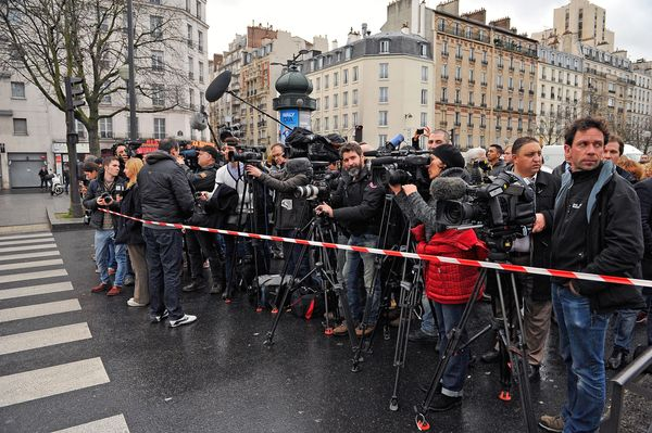 Media standby as police mobilize with reports of a hostage situation at Port de Vincennes on January 9, 2015 in Paris, France