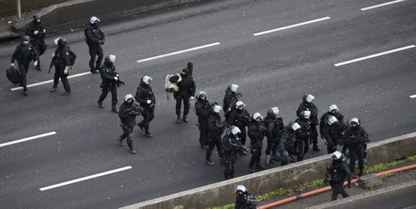 Members of the French police special force RAID gather on the 'peripherique' (circular road) in Porte de Vincennes, eastern P