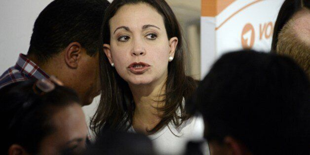 Opposition Leader Maria Corina Machado attends to the press conference in support of the arrested opposition leader Leopoldo