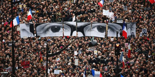 PARIS, FRANCE - JANUARY 11:  Demonstrators make their way along Boulevrd Voltaire in a unity rally in Paris following the rec