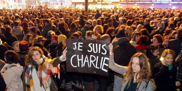 "Demonstrators hold a banner reading "" I am Charlie"", during a demonstration at the Old Port of Marseille, southern France, We"