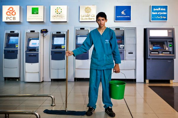 """June 2012, Ramallah, West Bank. Mohammad, 16, works for the cleaning company """"Wipe and shine"""" in a new shopping mall in Al Bi"""
